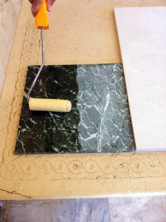 Application of professional colour intensifier on marble surface