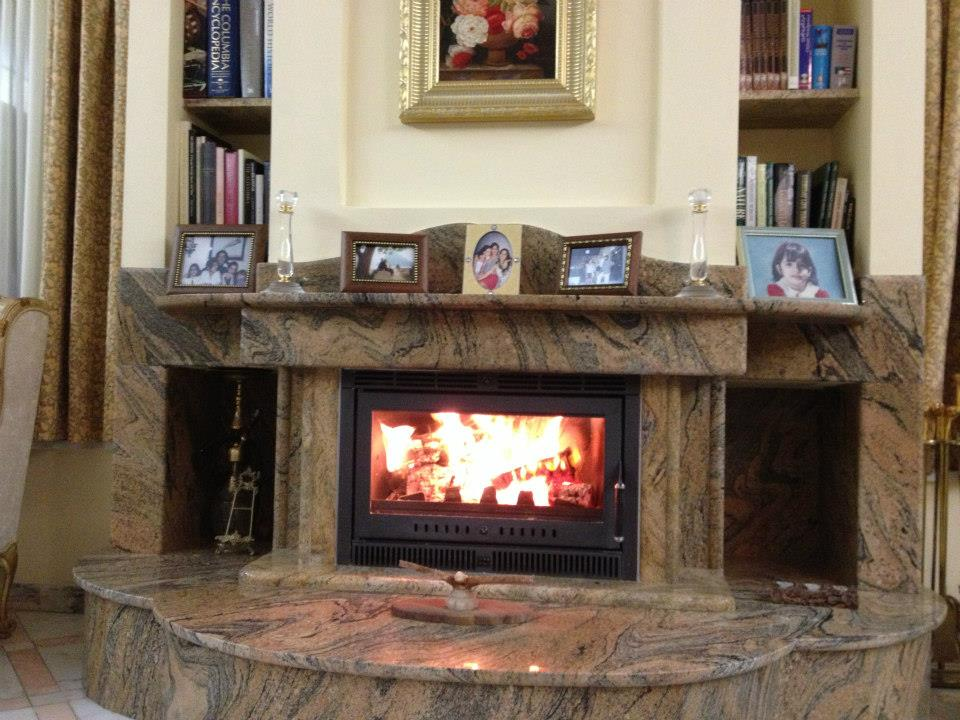 fireplaces made from marble granite and onyx alfa marble co s a rh alfamarble gr Onyx Stone Fireplace Modern Onyx Fireplace